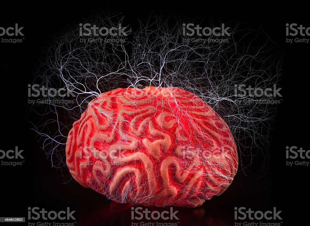 Human rubber brain with electric shocks stock photo
