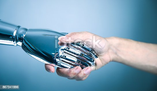 istock Human shaking hands with robot 867341886