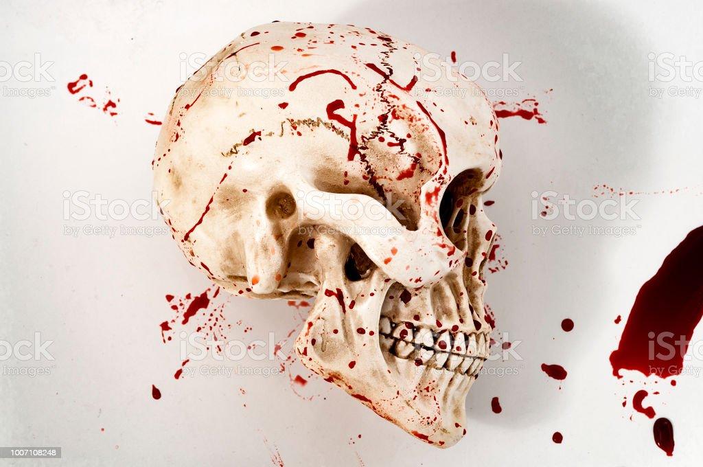 Human skull covered in blood splatter stock photo