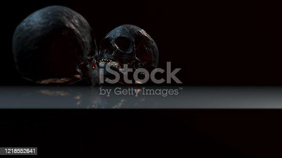 istock Human skull with dark background. Death, horror, anatomy and halloween symbol. 3d rendering, 3d illustration 1218552641