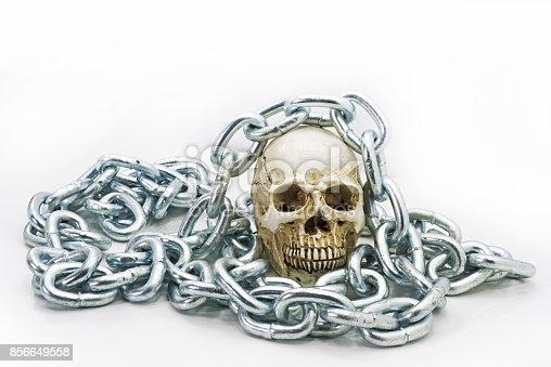 1176385551istockphoto Human skull with iron chain. 856649558