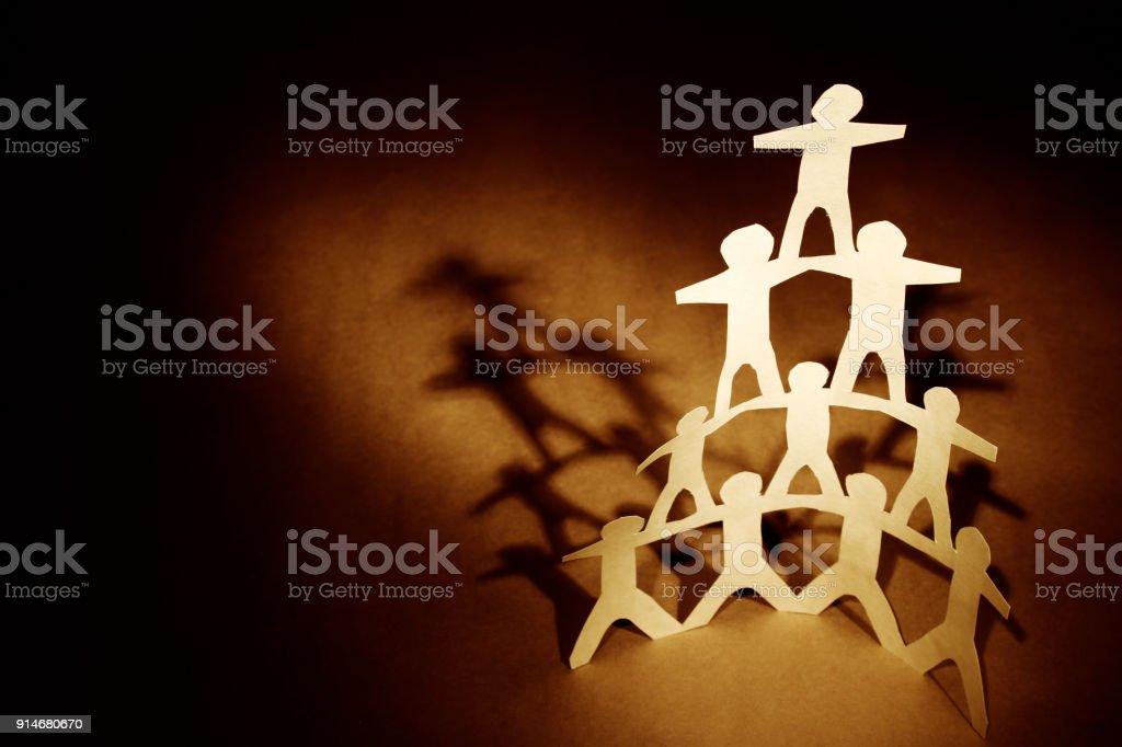Human team pyramid stock photo