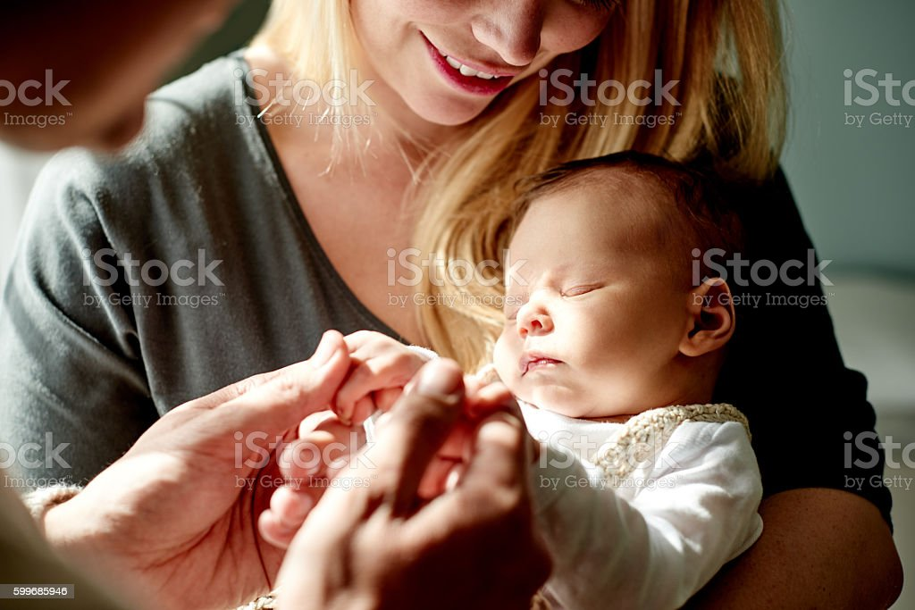 Human touch is soothing for both you and your baby stock photo