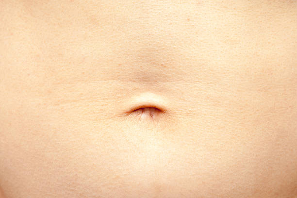 Human tummy and belly button stock photo