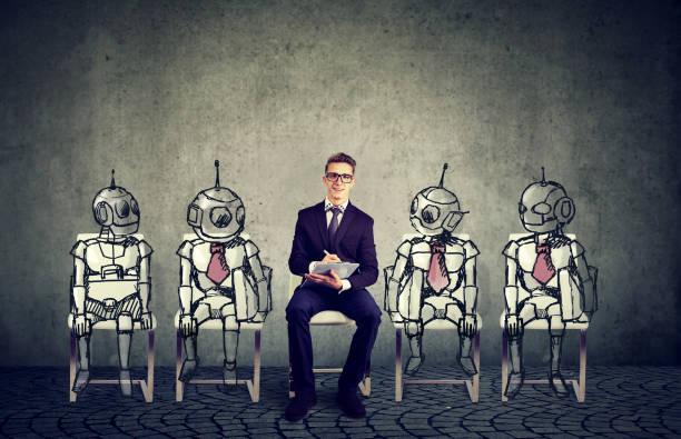 Human vs Robots concept stock photo