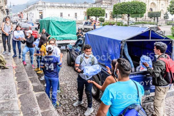 Antigua,, Guatemala -  June 5, 2018:  Volunteers load supplies outside town hall to take to area affected by eruption of Fuego (fire) volcano on June 3. Currently official figures say 121 people died & 300 missing.