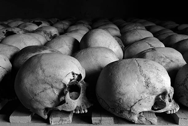 Humanity Rows of the skulls of victims of the Rwanda genocide of 1994.More information about this image here:http://www.istockphoto.com/forum_messages.phpthreadid=79537&messageid=1202570 mass murder stock pictures, royalty-free photos & images