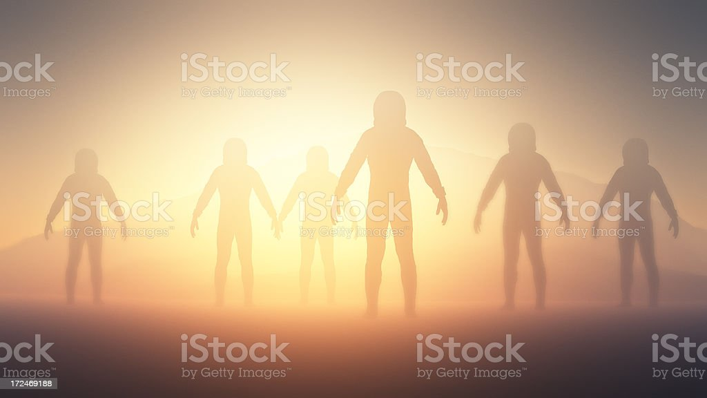 Humanoid aliens exploring planet stock photo