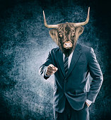 Humanoid cow - Cow head on man in a suit - Image manipulation