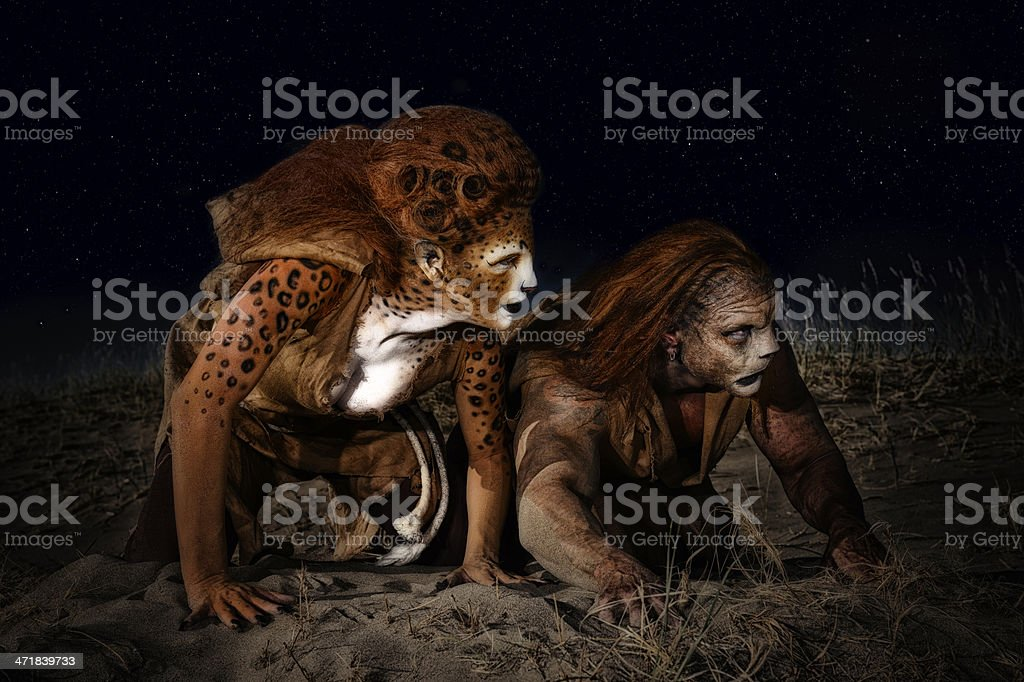 Humanoid Leopard and Lion Hunting By Moonlight In Africa stock photo