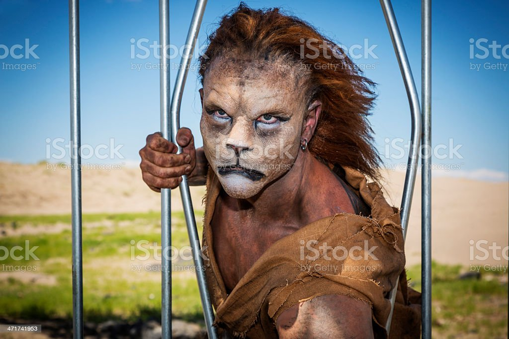 Humanoid Lion Escapes from a Cage stock photo