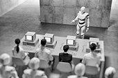 istock Humanoid robots teaching people in the office 1164218296