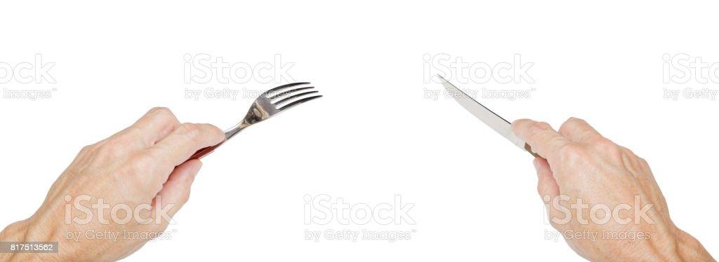 Menschen Hände halten eine silberne Gabel und Messer – Foto