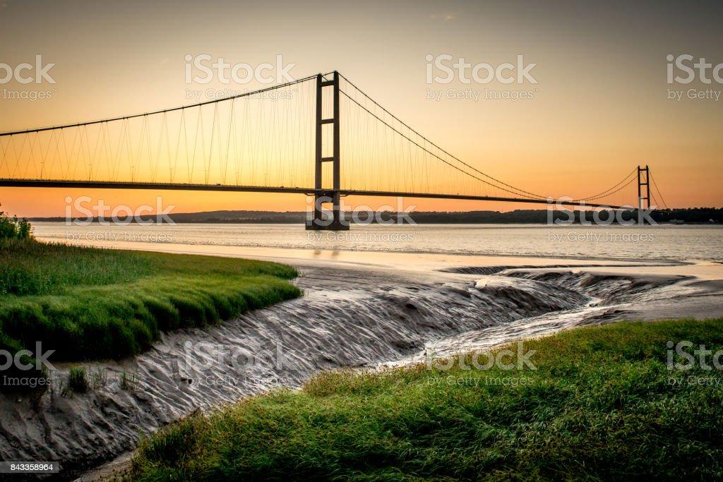 Humber bridge at low tide stock photo