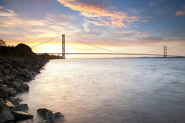 humber bridge at sunrise (hull, uk) - hull stock pictures, royalty-free photos & images