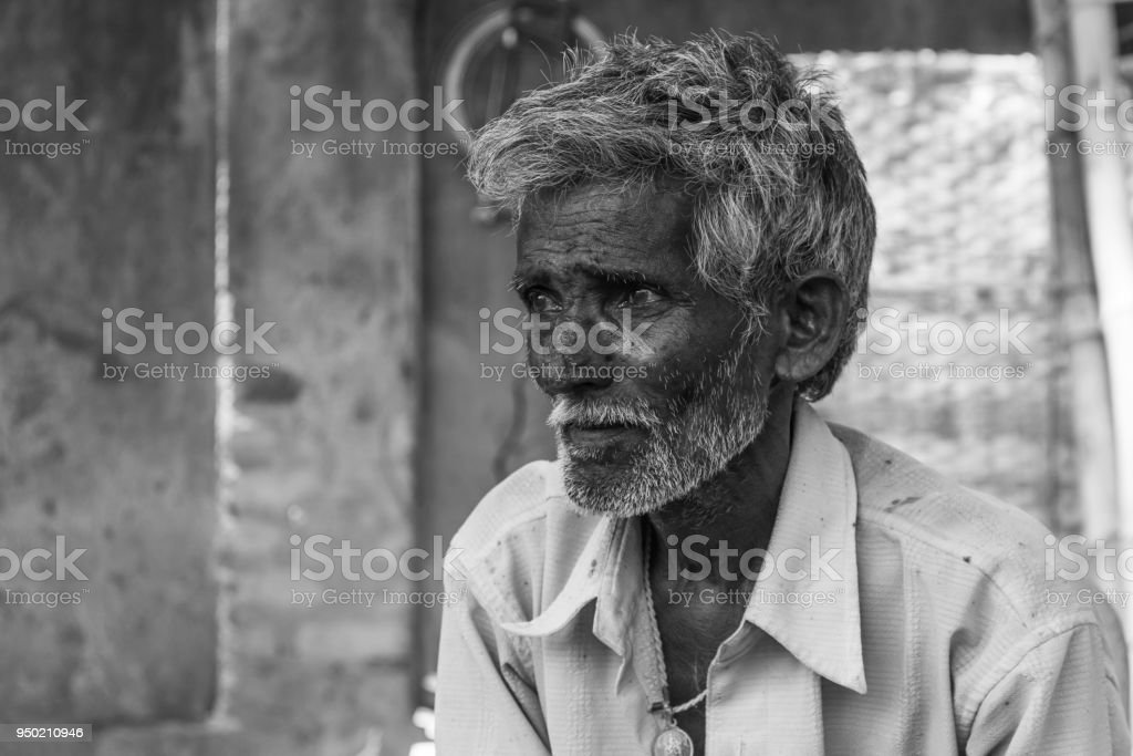 Humble elder man portrait stock photo