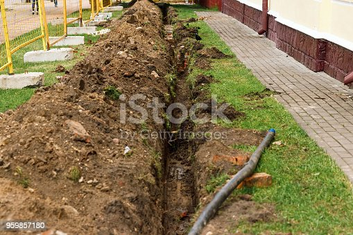istock Hume pipe laying for water transportation.Under ground water pipe.Concrete piping.Pipe and man hole. 959857180