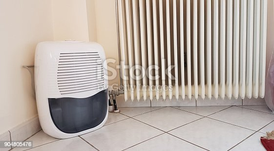 177118473 istock photo humidifier and  heater old in the room 904805476