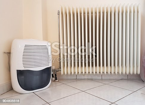 istock humidifier and  heater old in the room 904805518