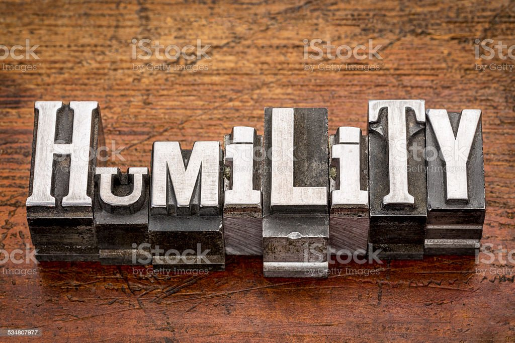 humility word in metal type stock photo