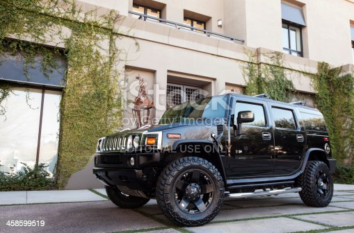 Scottsdale, United States - January 25, 2012: A photo of a parked black Hummer H2. The H2 is the predecessor to the well known military used Hummer H1.