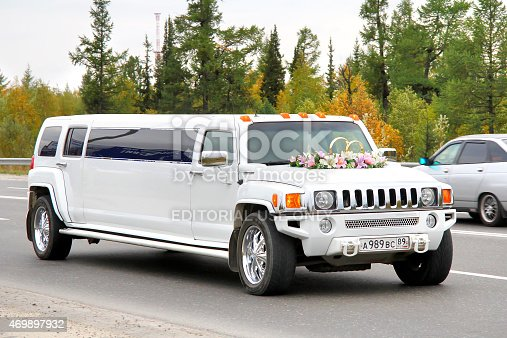 Novyy Urengoy, Russia - August 31, 2012: White Hummer H3 wedding limousine drives at the city street.