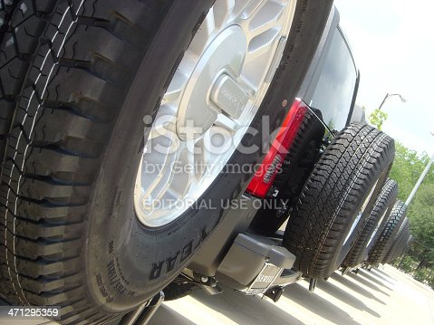 133277230 istock photo Hummer SUVs with Good Year Tires on dealership parking lot 471295359