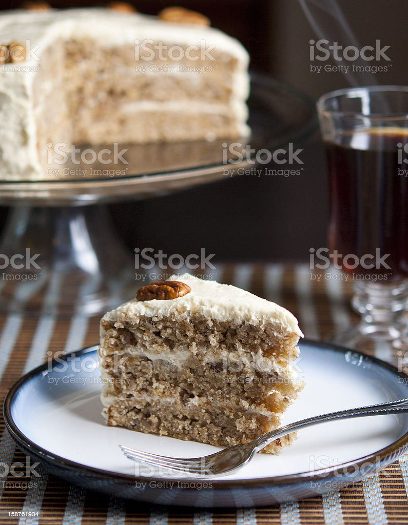 Hummingbird cake on a plate with a fork royalty-free stock photo