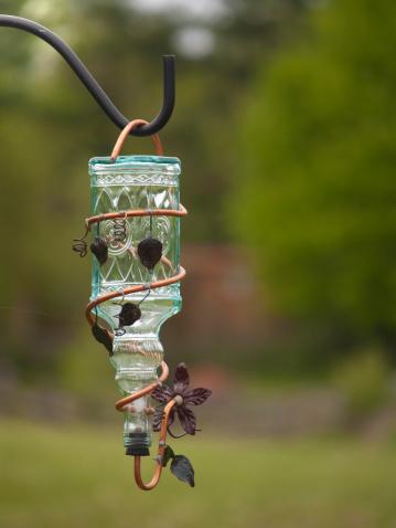 Close-up shot of a hummingbird feeder.