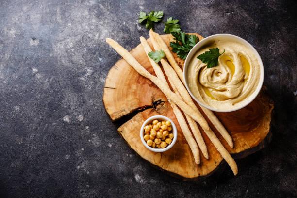 hummus and Bread sticks stock photo