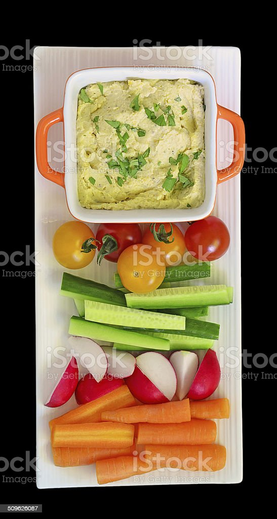 Hummus and raw vegetables stock photo