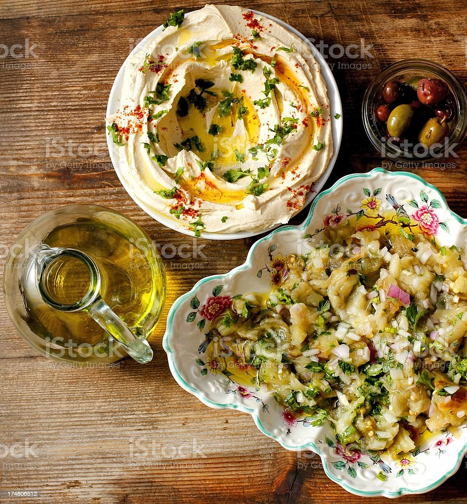Hummus, Baba Ghanoush  and olives stock photo