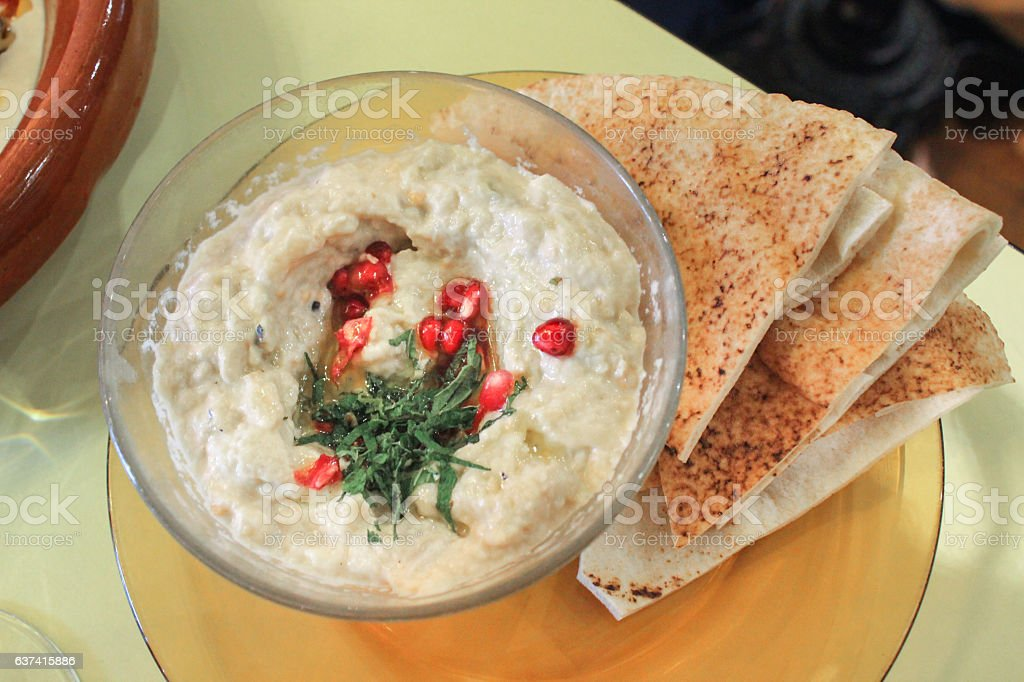 Hummus dip and pita bread for healthy appetizer stock photo