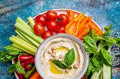 istock Hummus platter with assorted snacks. 1204149669
