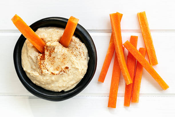 hummus with carrot sticks top view - cenoura imagens e fotografias de stock