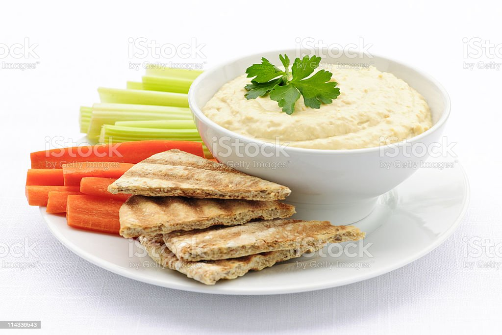 Hummus with pita bread and vegetables stock photo