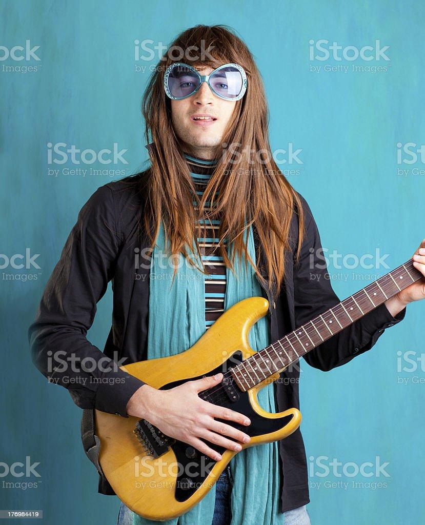 humor retro vintage hip heavy seventies guitar playe royalty-free stock photo
