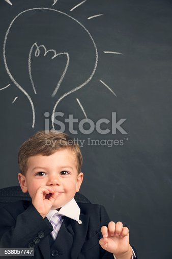 480585411 istock photo Humorous big business idea concept. Young child in a suit 536057747