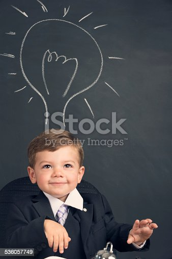 480585411 istock photo Humorous big business idea concept. Young child in a suit 536057749