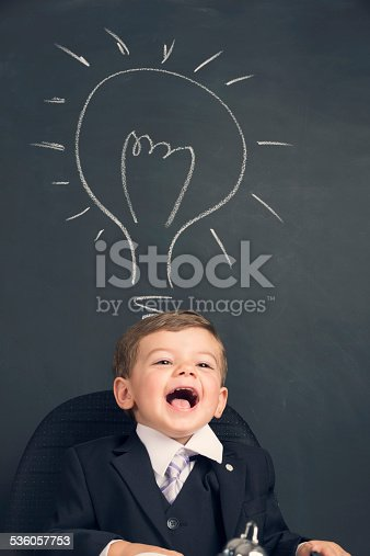 480585411 istock photo Humorous big business idea concept. Young child in a suit 536057753