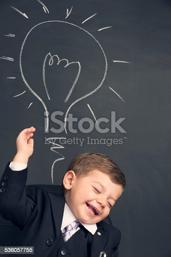 480585411 istock photo Humorous big business idea concept. Young child in a suit 536057755
