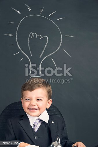 480585411istockphoto Humorous big business idea concept. Young child in a suit 539260155