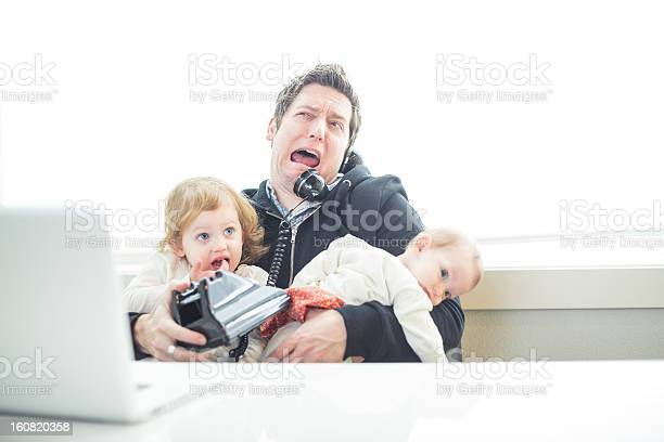 Humorous dad in office trying to multitask work and parenting picture id160820358?b=1&k=6&m=160820358&s=612x612&h=2oi5ox mekyr qz7fuhmqkramov1i6iwmlrogmrpv6c=