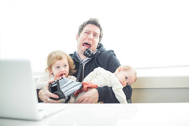 humorous dad in office trying to multitask work and parenting - humor bildbanksfoton och bilder