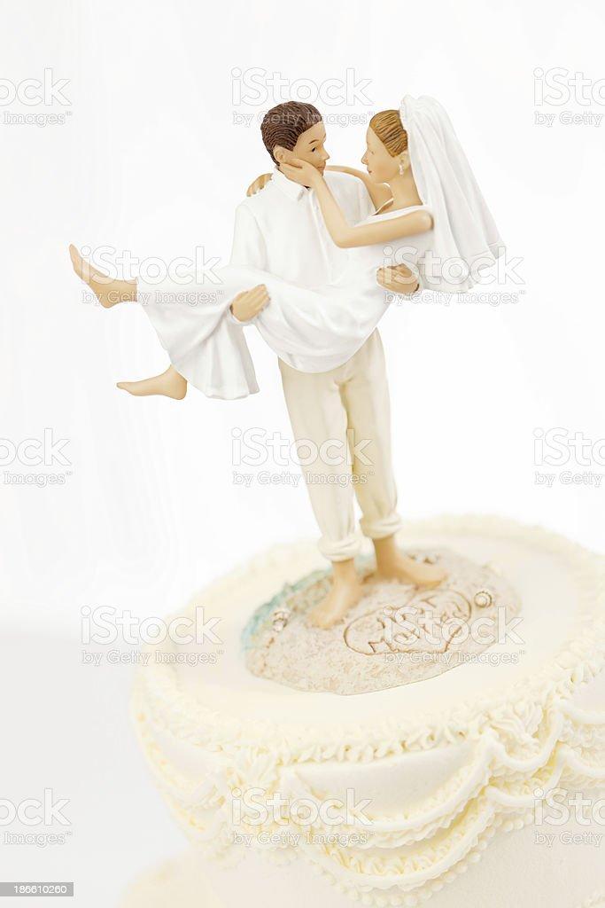 Humorous Destination Wedding Cake Topper Close-up royalty-free stock photo