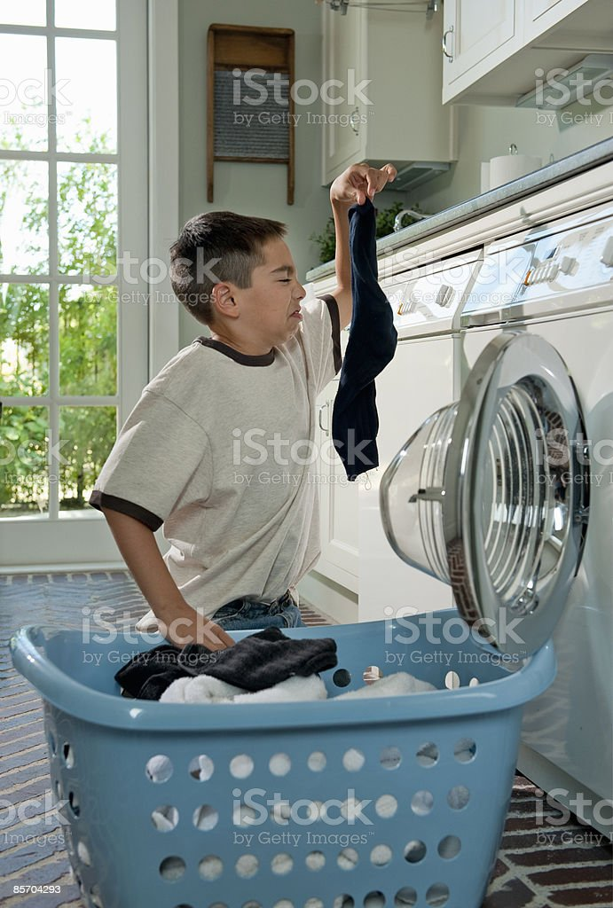 Humorous Picture of Boy doing Laundry Chores royalty-free stock photo