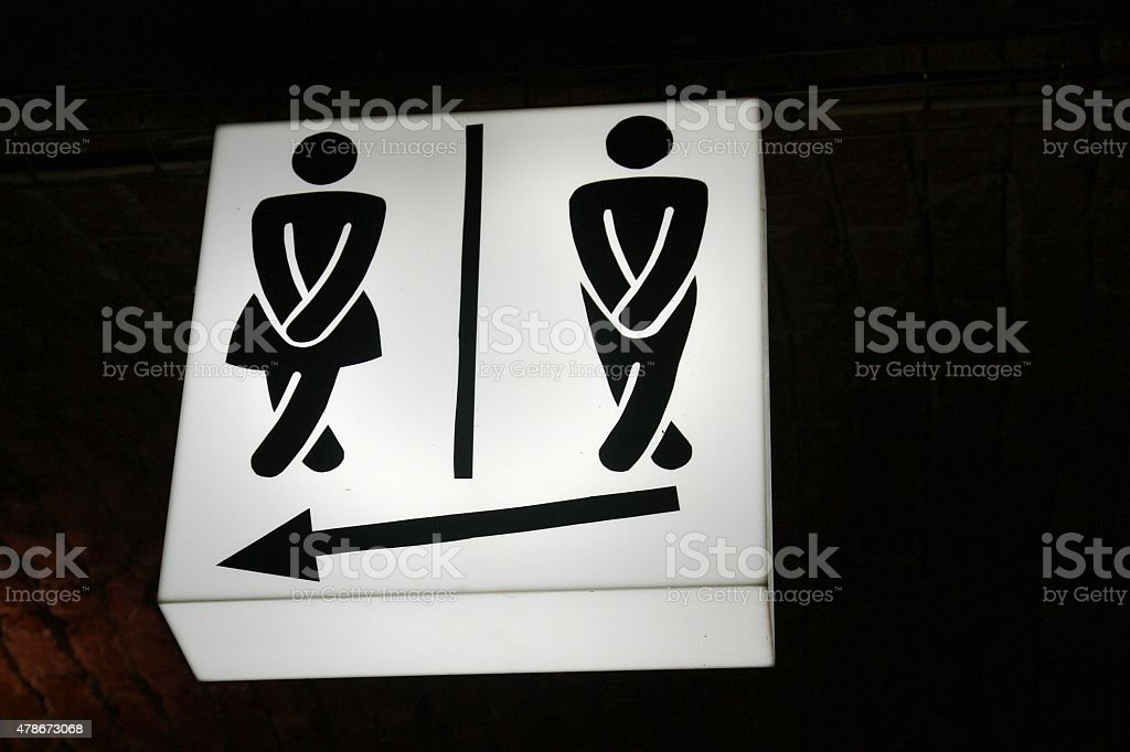 humorous  sign indicating male and female toilet facilities stock photo