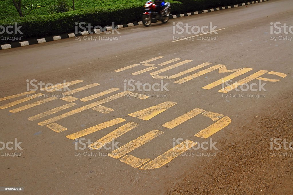 Hump Ahead Road Warning royalty-free stock photo