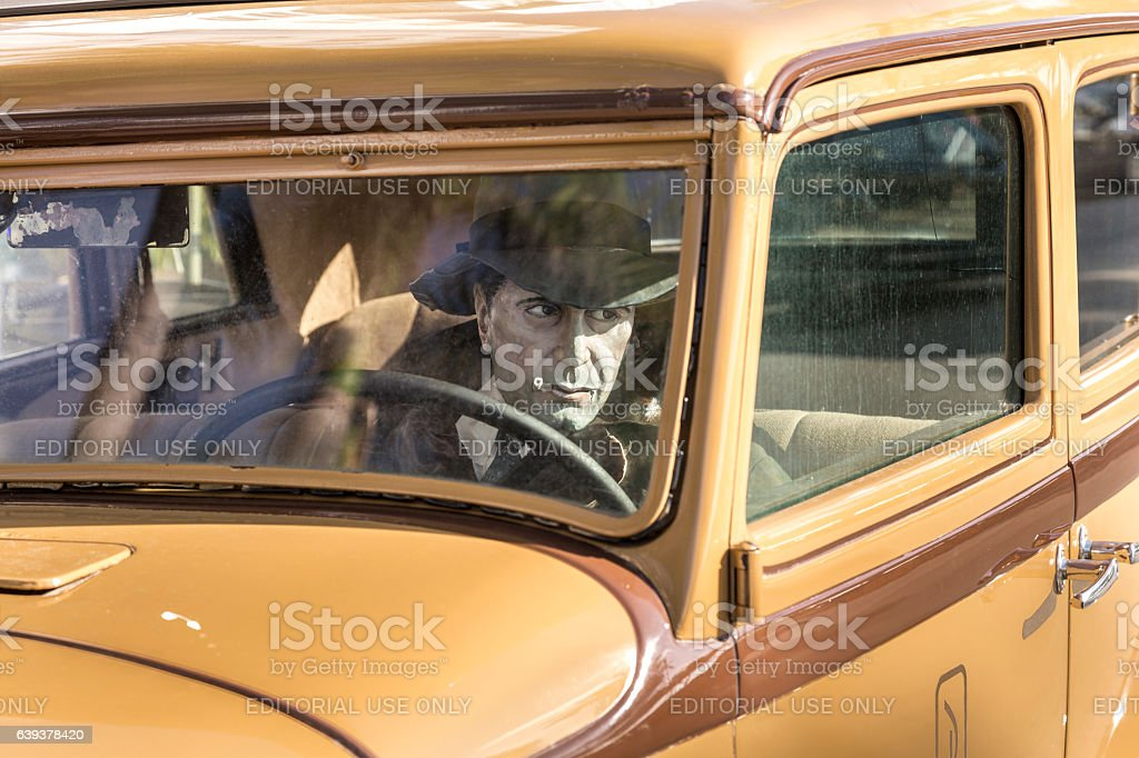 Humprey Bogart as driver in an old vintage car stock photo