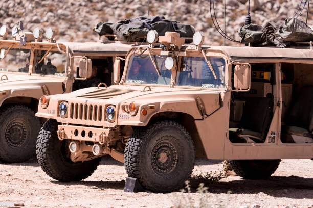humvee vehicles on deployment during war - land vehicle stock photos and pictures